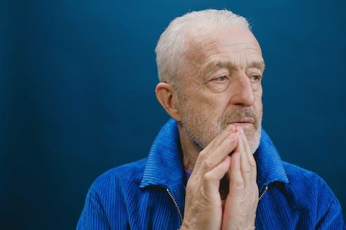Elderly Man in Blue Jacket