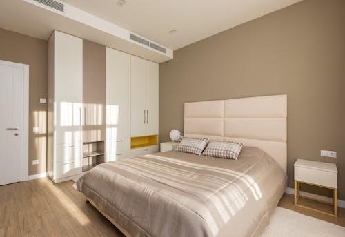 A Modern Design Bedroom with Window Light Shining Inside