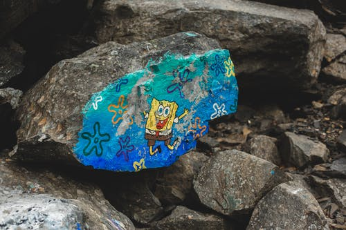 Stone with painted cartoon character