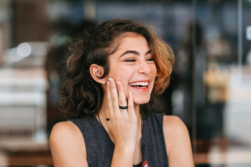 Shallow Focus Photo of a Beautiful Woman Laughing