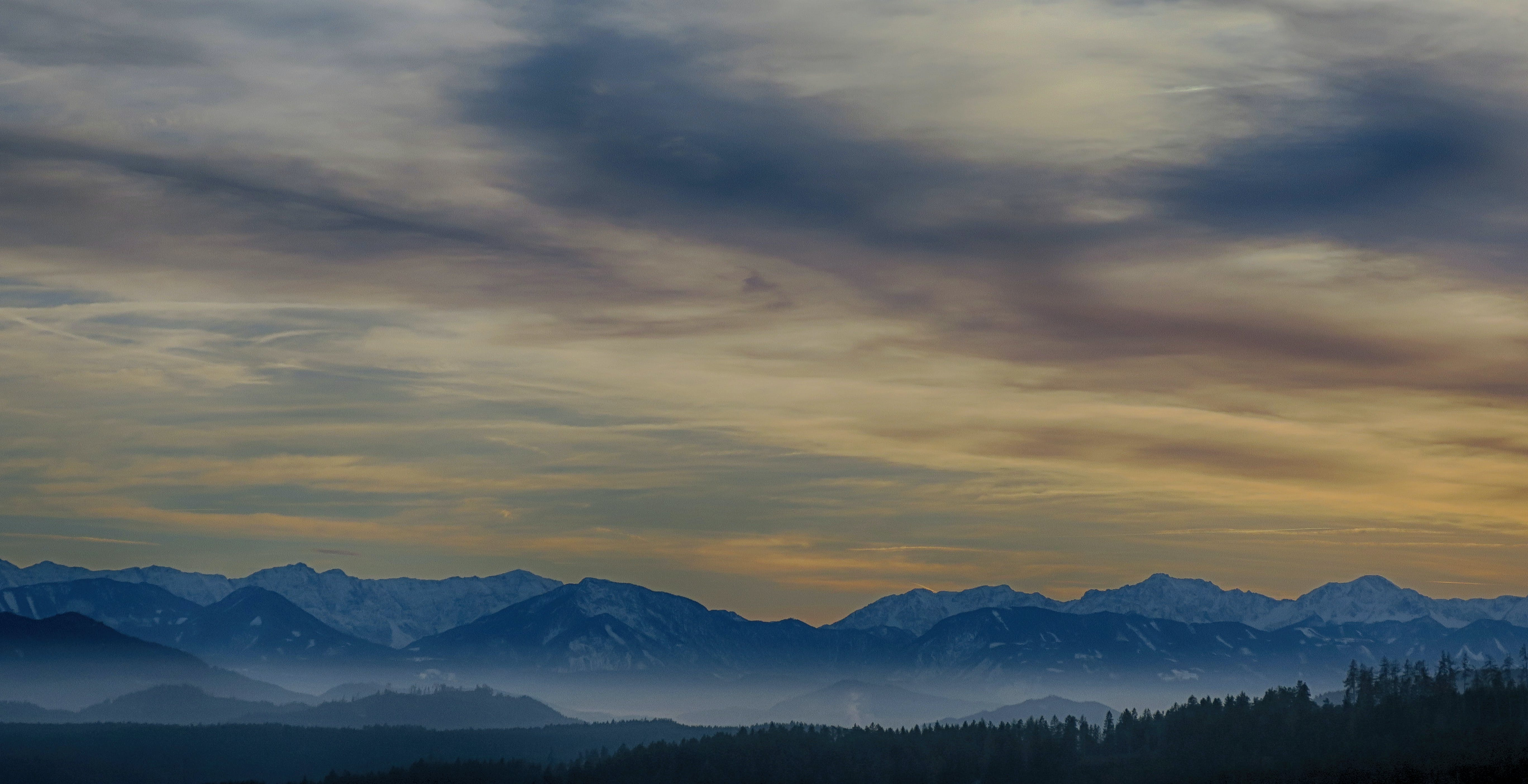 Tall Mountains Surrounded by Fogs Below the Clouds High-saturated Photography