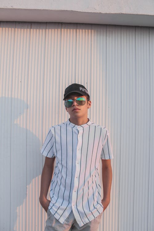 A Man Wearing Sunglasses and a Striped Shirt