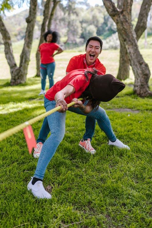 Man And Woman Playing Tug-of-war