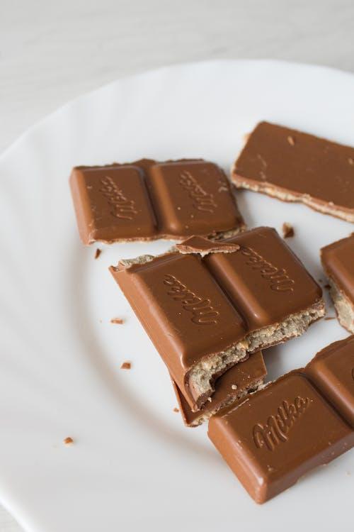 Close-Up Photo of Chocolates on White Ceramic Plate