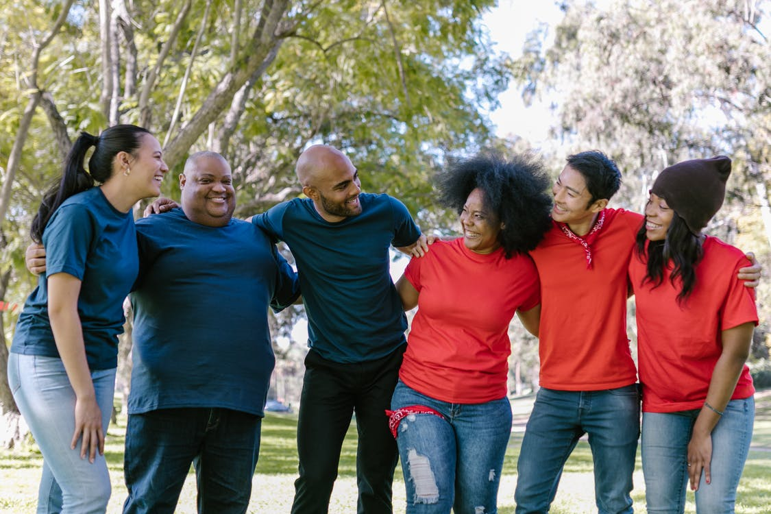 Group of People Wearing Blue and Red Shirts