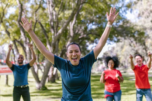 Woman In Blue Crew Neck T-shirt Raising Her Hands