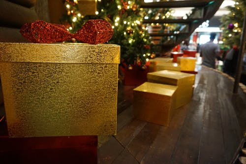 Free stock photo of christmas box, gold box, red ribbon