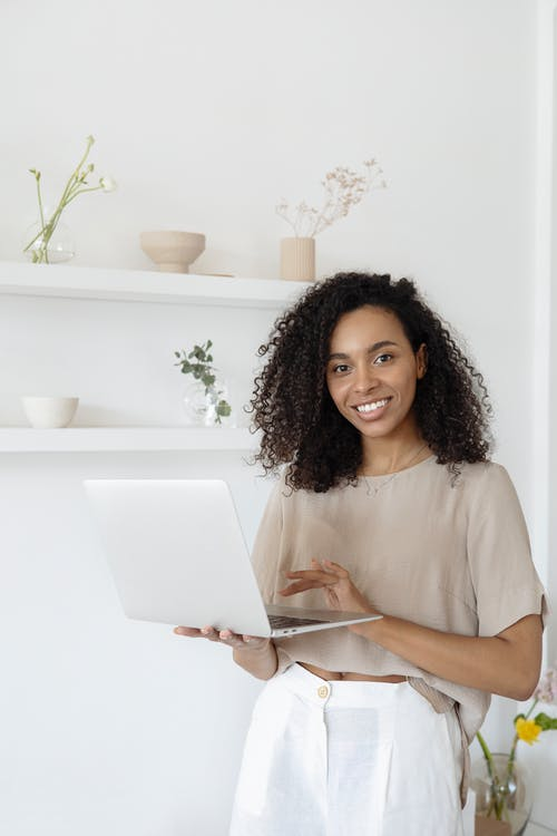 Smiling Woman Carrying Laptop