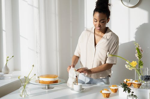 Woman Pouring Coffee Drink on a Ceramic Cup