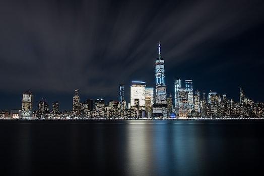 High-rise Buildings at Night Near Sea