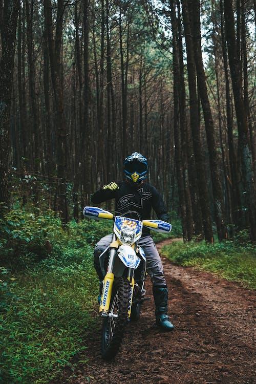 Man in Helmet on Motorbike on Dirty Road