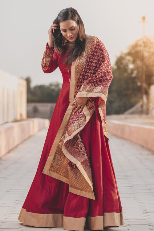 Woman in Red and Brown Hijab Standing on Road