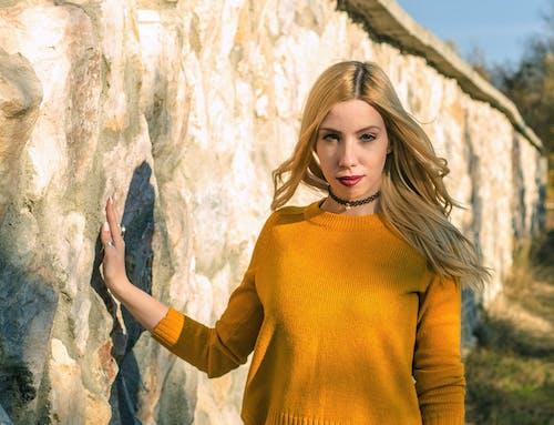 Woman In Yellow Crew-neck Sweatshirt