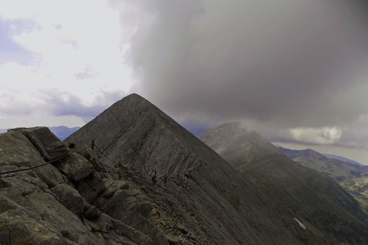 Mountain Range Under Grey Skies