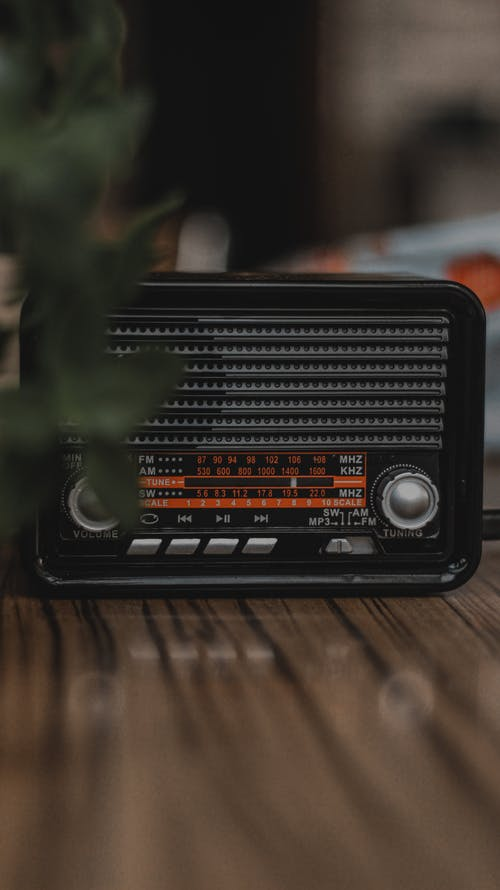 Black Radio on Brown Wooden Table