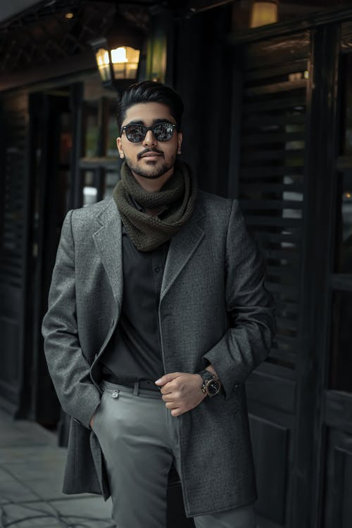 Man in Black Coat Wearing Black Sunglasses and Brown Scarf