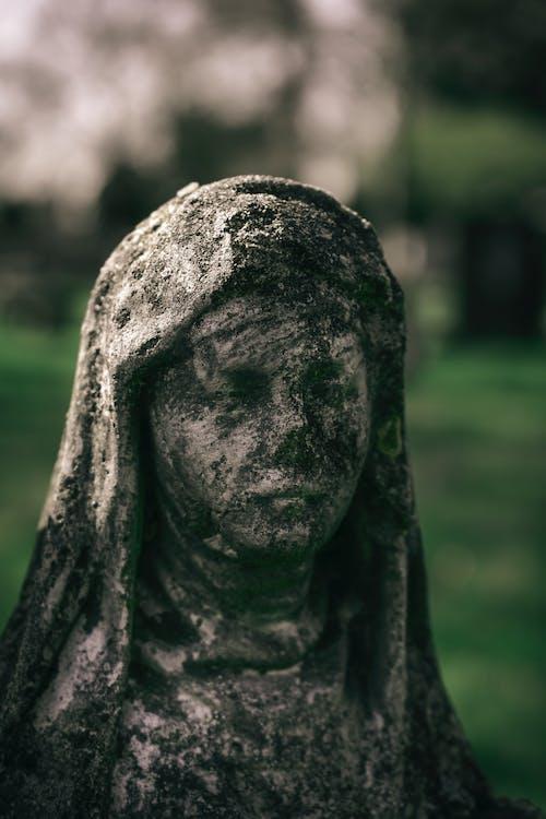 Close Up Photo of Concrete Statue