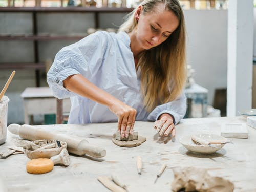 Woman in White Shirt Working with Pottery Clay
