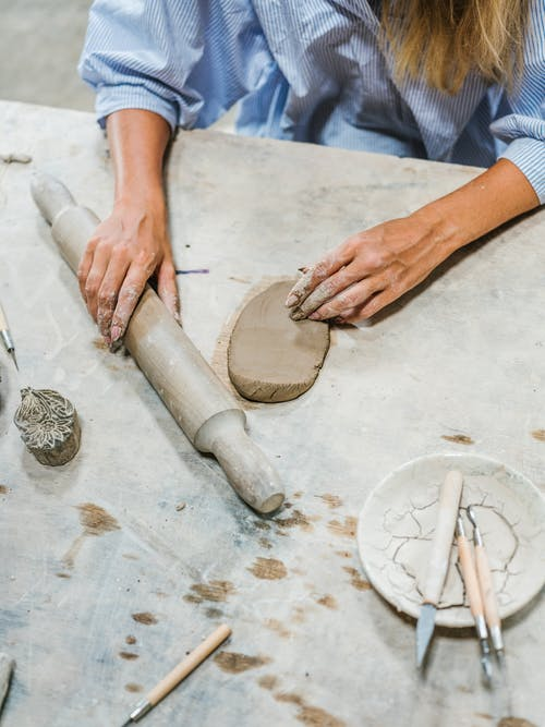 Person Holding Wooden Rolling Pin