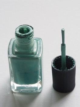 Shallow Focus Photography of Teal Nail Lacquer
