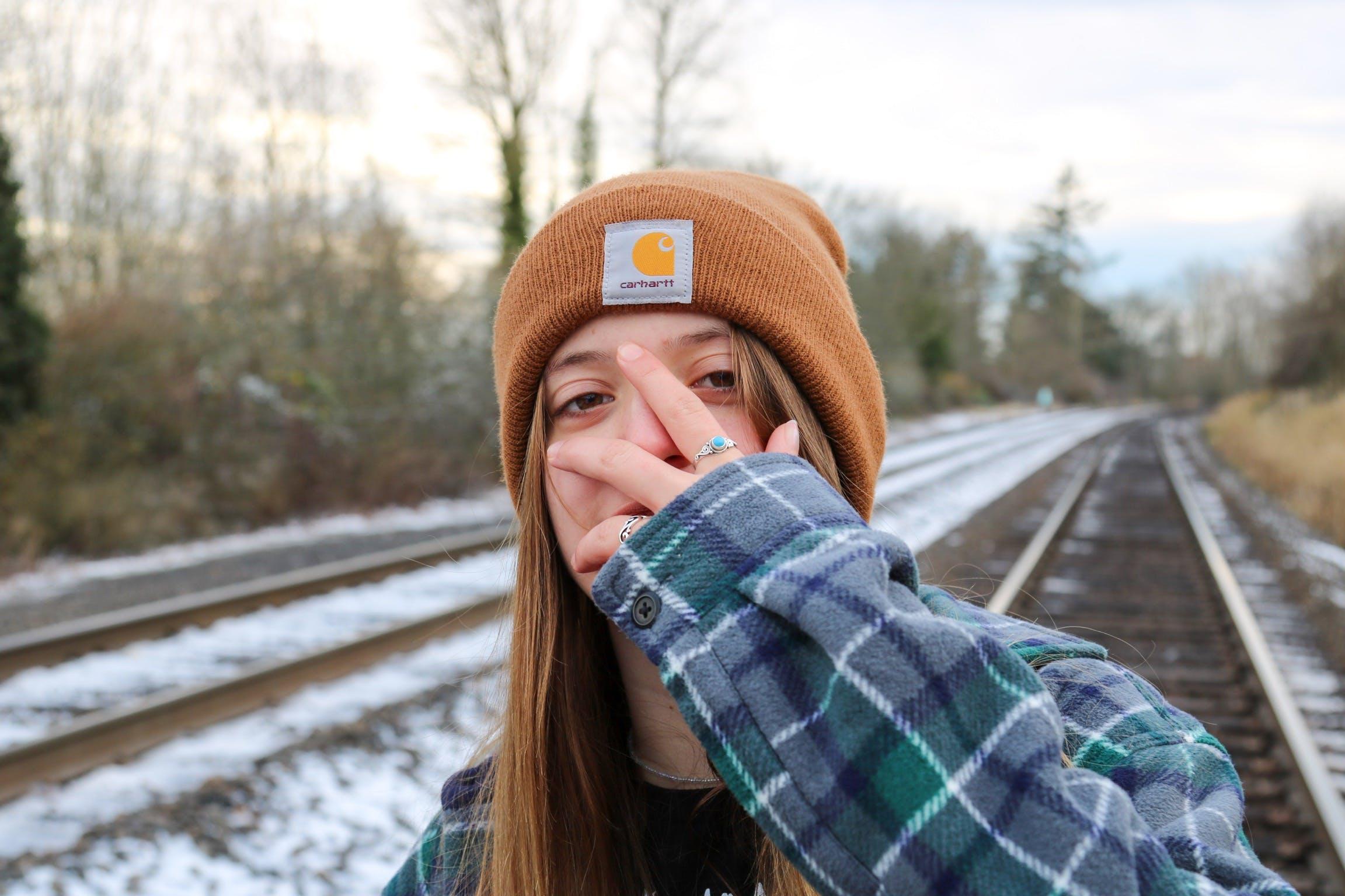 Free stock photo of cold, girl, hand, headshot