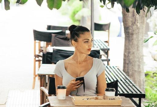 Woman Wearing Grey Shirt Sitting on Chair