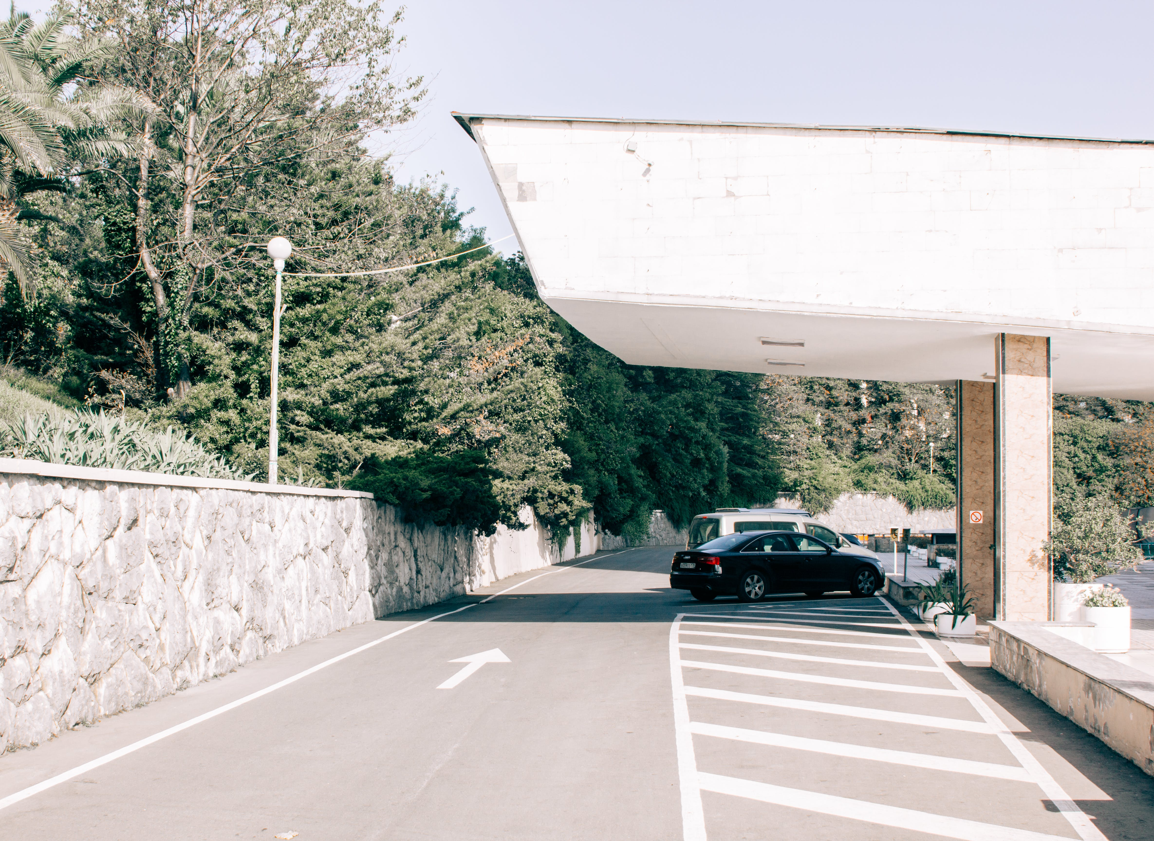 Black Car Parked on Gray Pavement