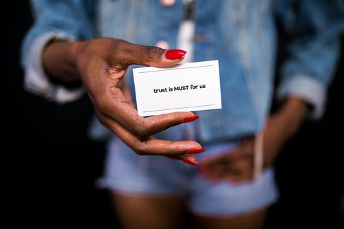 Close-Up Shot of a Person Holding a Card