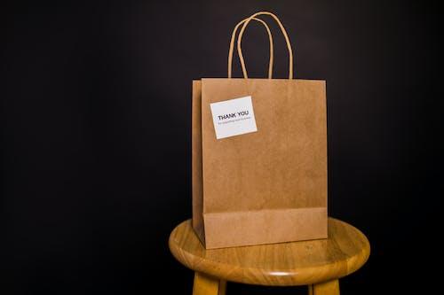 Brown Paper Bag on Brown Wooden Stool