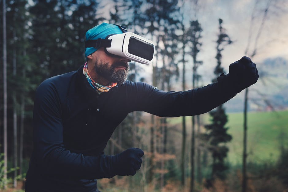 Person Wearing Black Henley Shirt and White Vr Goggles