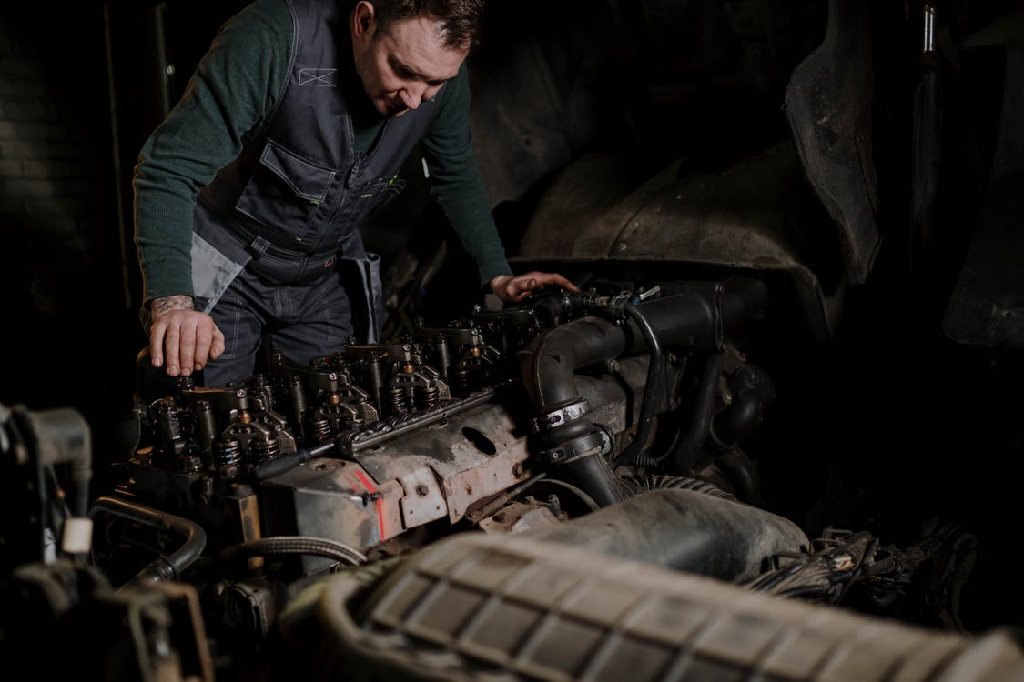 A service technician working on a car's engine