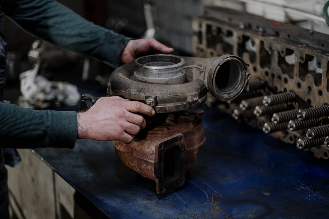 Person Holding a Engine Turbo
