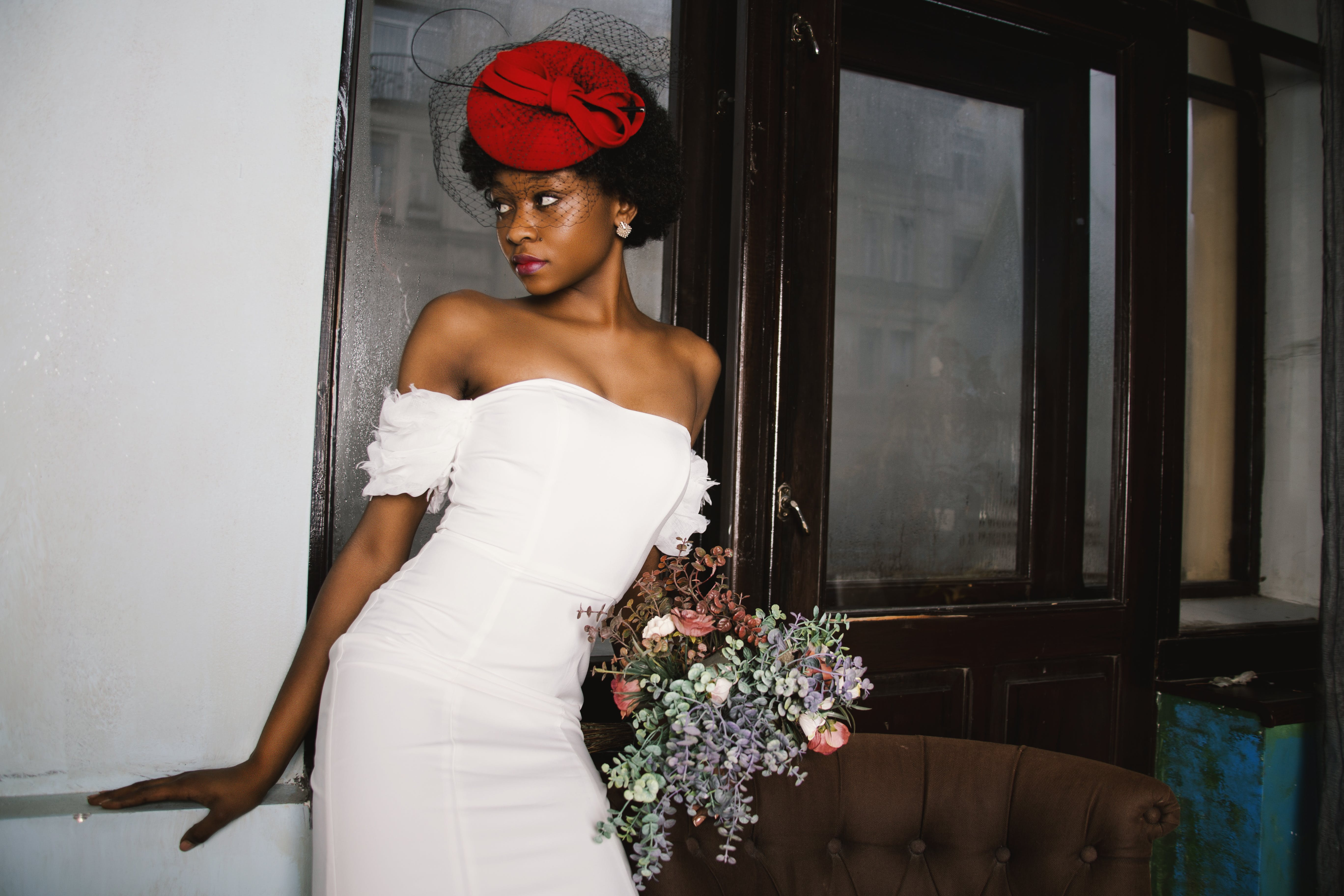 Woman in White Off-shoulder Dress Holding Bouquet