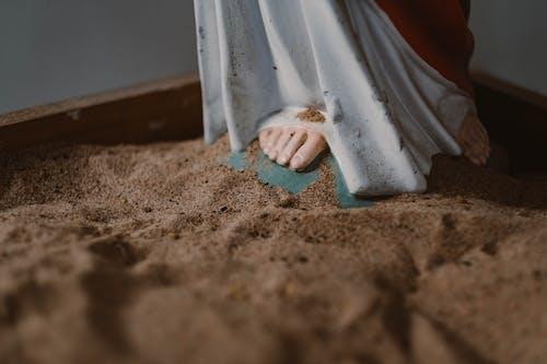 Jesus Christ Figurine on a Sand