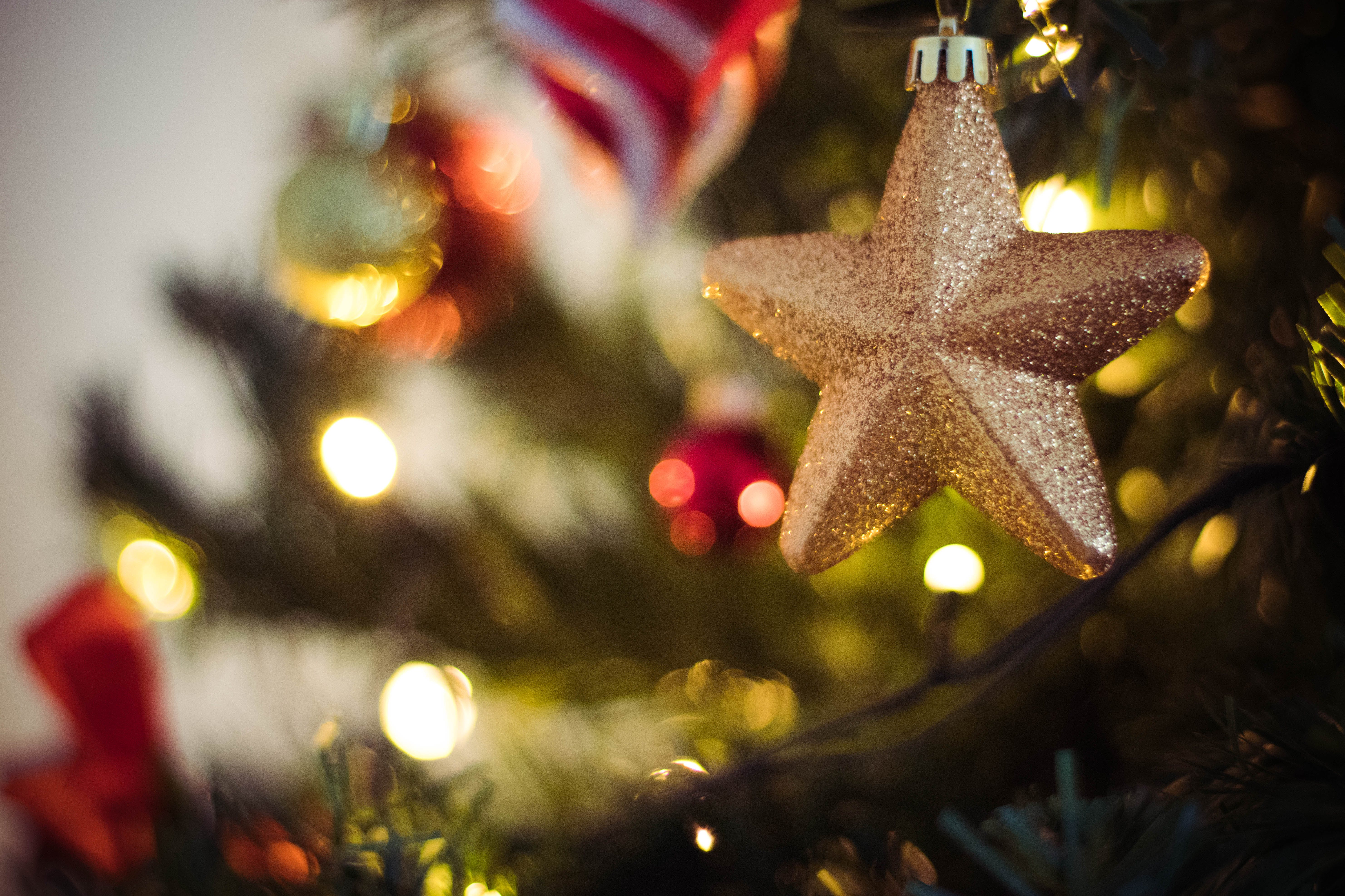 Selective Focus Photography of Gold Star Bauble