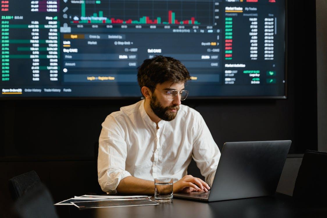 Man in White Dress Shirt Using Black Laptop Computer