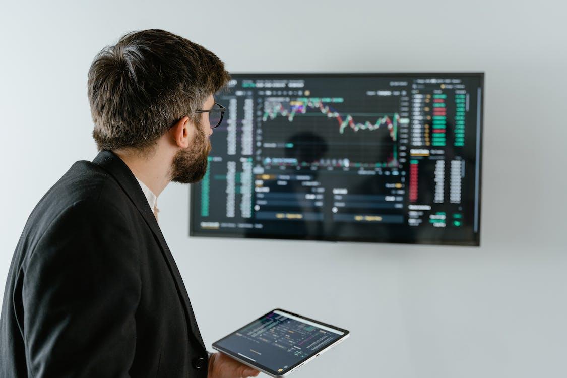 Man in Black Suit Jacket Using Laptop Computer
