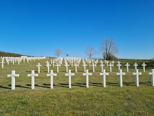 White Cross on Green Grass Field