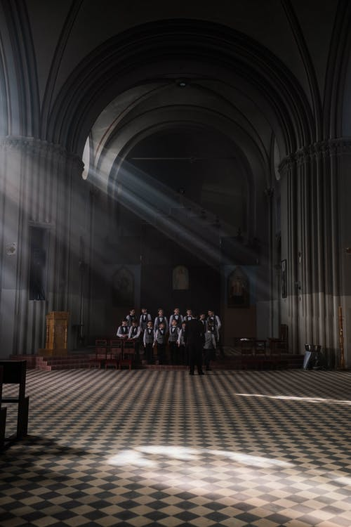 Group of Boys in a Dark Room with Sun Rays