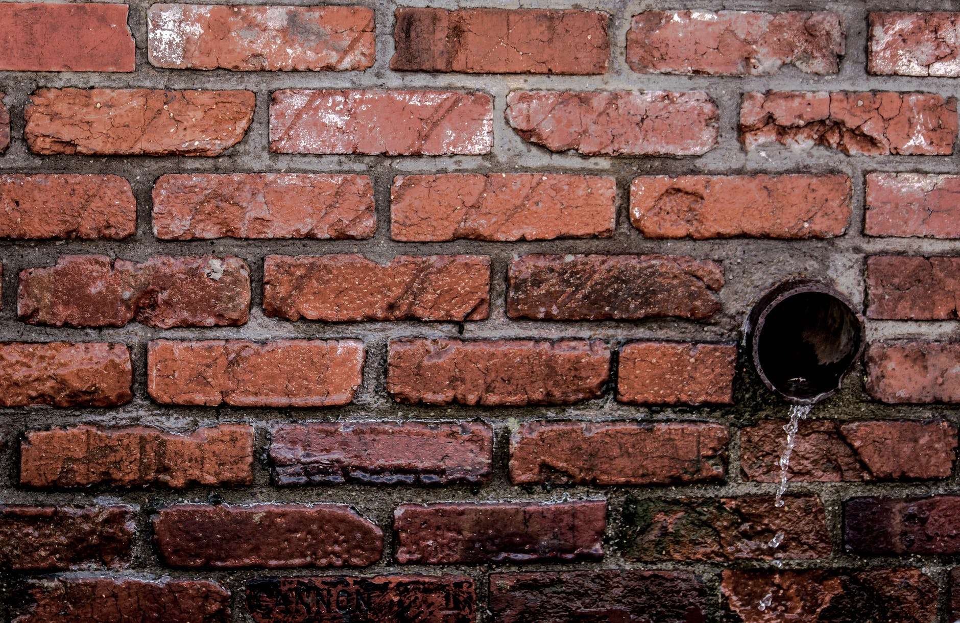 Brick wall and pipe drainage