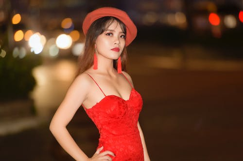 Photo of a Woman Wearing Red Dress