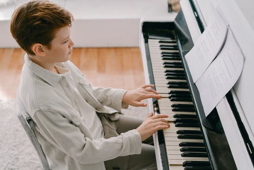 Photo of a Boy Playing Piano