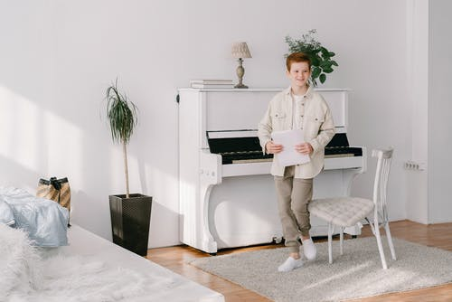 Boy Wearing a Long Sleeve Polo and White Sneakers