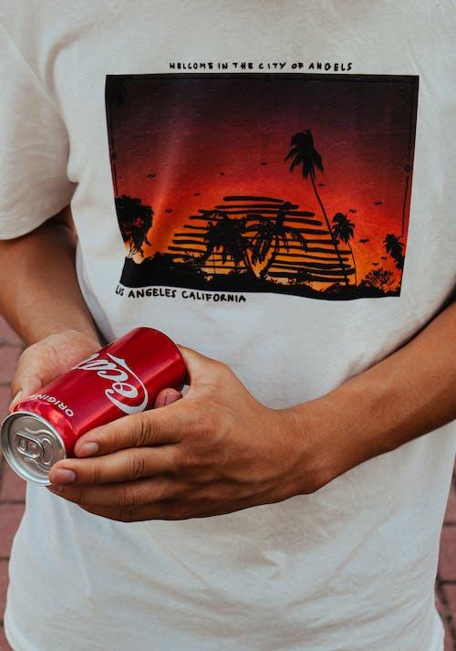 A Person Holding Coca Cola Can