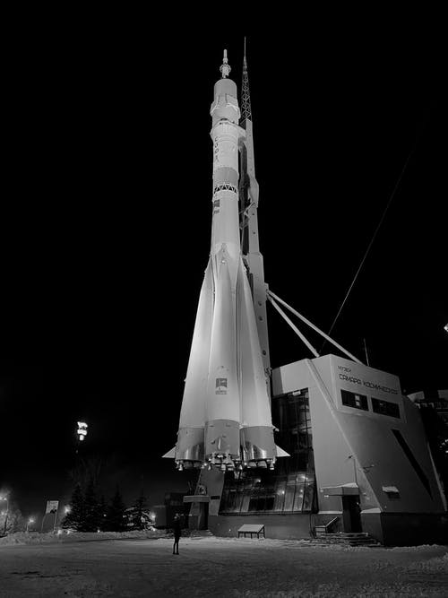 Grayscale Photo of a Rocket