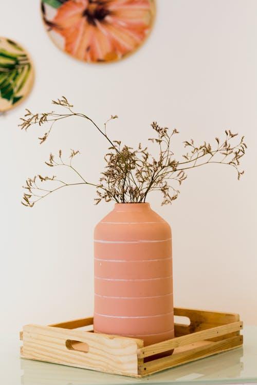 Brown Ceramic Vase on Brown Wooden Table
