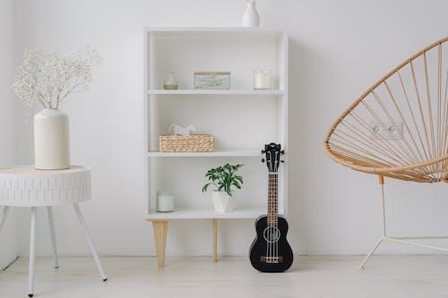 Black Acoustic Guitar on White Wooden Shelf