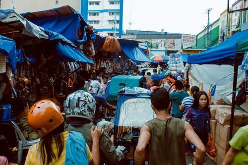 Photography of People in the Market Place