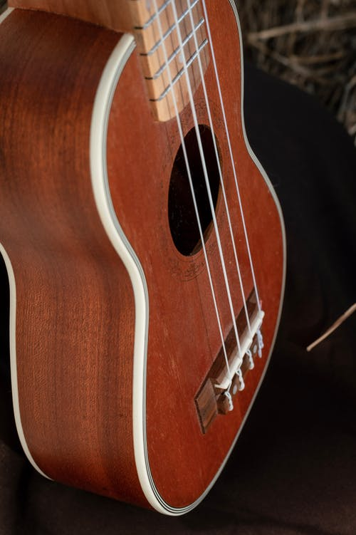 Close-Up Photo of a Brown Wooden Ukulele