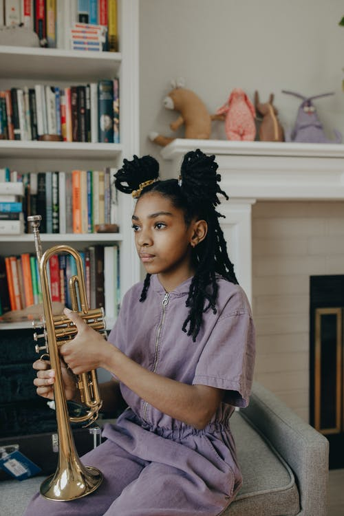 Girl Holding a Trumpet